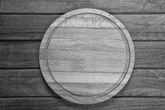 Cutting board on wooden background Stock Photography