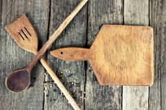 Cutting board and wooden spoons Royalty Free Stock Images
