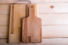 Cutting board on the wooden table background with copy place. To Stock Photo