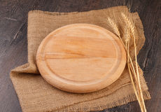 Cutting board on a wooden table Royalty Free Stock Photos