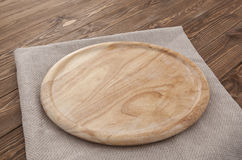 Cutting board on a wooden table Stock Image