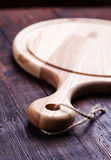 Cutting Board on wooden table. Stock Image