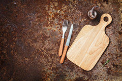 Cutting boards, knife and fork on a rustic Royalty Free Stock Photo