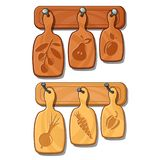 Cutting boards on nails. Kitchen wooden implements with images of fruits and vegetables. Vector isolated on white Royalty Free Stock Photography
