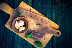 Cutting boards spices old wooden table Royalty Free Stock Image