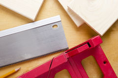 Cutting boards using the miter box and saw. Stock Photos