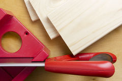 Cutting boards using the miter box and saw. Royalty Free Stock Photography