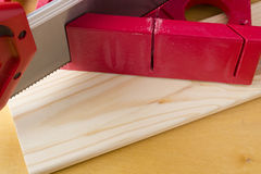 Cutting boards using the miter box and saw. Stock Photo