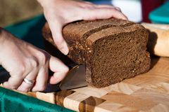 Cutting bread. Sliced bread on a wood cutting board Stock Photography