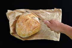 Cutting bread Stock Photos