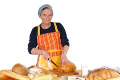 Cutting bread. Royalty Free Stock Image