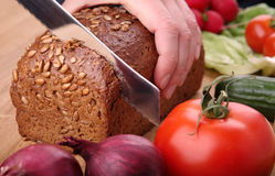Cutting the bread Royalty Free Stock Image