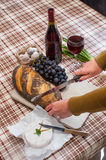Cutting bread for for cheese and wine Royalty Free Stock Photography