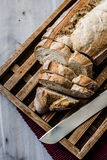 Cutting bread Stock Image