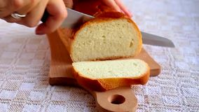 Cutting bread on the kitchen