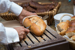 Cutting bread loaf Royalty Free Stock Photography