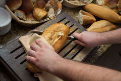 Cutting bread loaf Royalty Free Stock Images