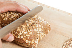 Cutting bread Stock Photo