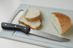Cutting bread Stock Images