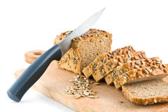Cutting of bread with sunflower seeds Royalty Free Stock Images
