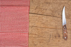 Cutting breadboard and knife over red Stock Image