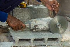 Cutting bricks Stock Photo