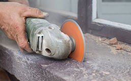 Cutting bricks using grinders. The process of cutting concrete and bricks using grinders Stock Photo
