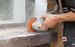 Cutting bricks using grinders. The process of cutting concrete and bricks using grinders Stock Photography