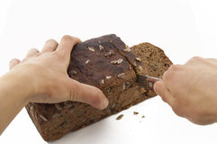 Cutting Brown Bread Royalty Free Stock Image