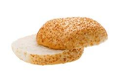 Cutting bun with sesame seeds Royalty Free Stock Image