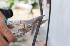 Cutting cable Stock Photos