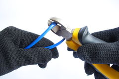 Cutting cable Stock Images