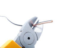 Cutting cable with nippers Stock Images