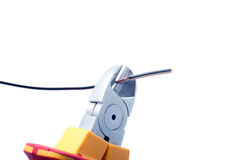 Cutting cable with nippers Royalty Free Stock Photos