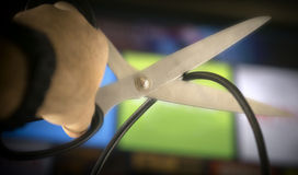 Cutting the cable on Tv Royalty Free Stock Photography