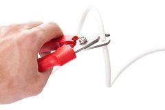 Cutting cable using nippers Stock Photography