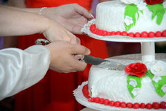 Cutting of the cake. Royalty Free Stock Image