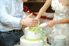 Cutting Cake with Orchids Royalty Free Stock Image