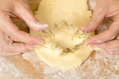 Cutting the Canadian Maple Leaf Cookies Royalty Free Stock Image