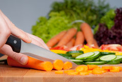 Cutting carrot Royalty Free Stock Photography