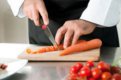 Cutting carrot Stock Image