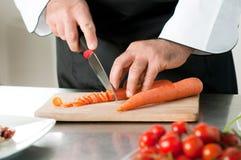 Cutting carrot Stock Image