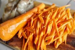 Cutting carrot Stock Photos
