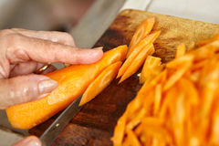 Cutting carrot Royalty Free Stock Images