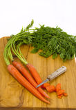 Cutting Carrots on a cutting board Royalty Free Stock Image