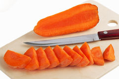 Cutting the carrots and a knife on a cutting board Royalty Free Stock Photography