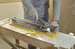 Cutting Ceramic Tiles. Royalty Free Stock Images