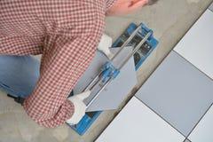 Cutting ceramic tiles Royalty Free Stock Photos