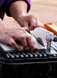 Cutting Ceramic tiles on a Wet Tile Saw. Worker cutting Ceramic tiles using a Wet Tile Saw stock photo