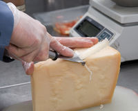 Cutting cheese Royalty Free Stock Images